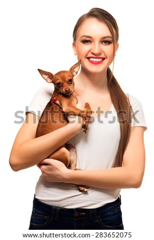 Young woman with a dog, isolated on white, copyspace - stock photo