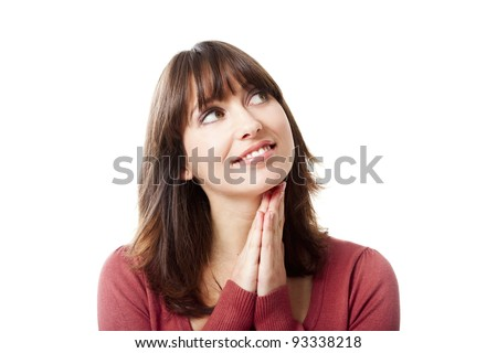 Young woman with a dreaming expression having happy thoughts, isolated on white backgroiund - stock photo