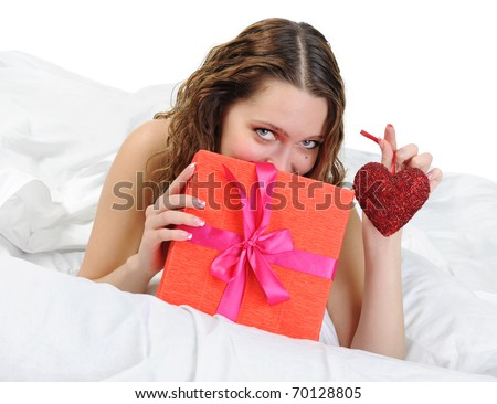 young woman with a gift box in the bed. Isolated on white background - stock photo