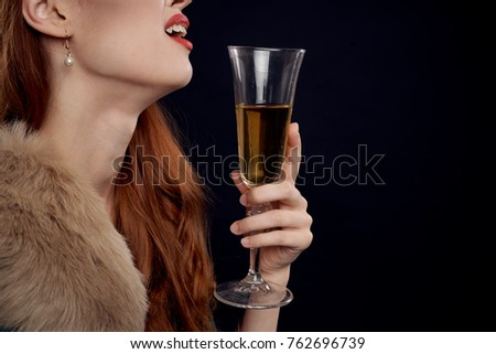 young woman with a glass of champagne, alcoholism, holiday