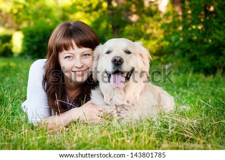 Young woman with a golden retriever - stock photo
