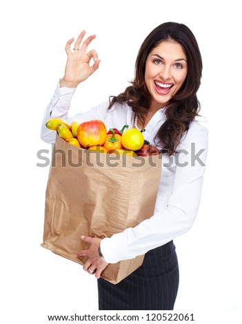 Young woman with a grocery bag. Isolated over white background. - stock photo