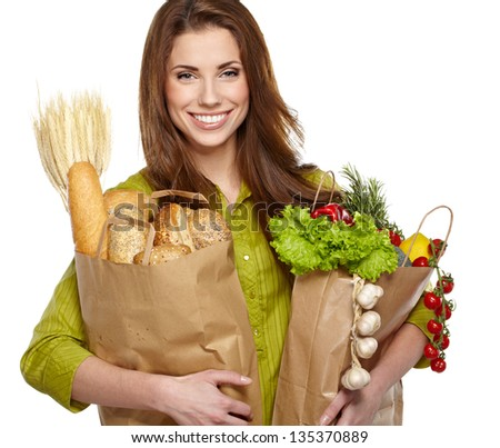 Young woman with a grocery shopping bag. Isolated on white background. - stock photo