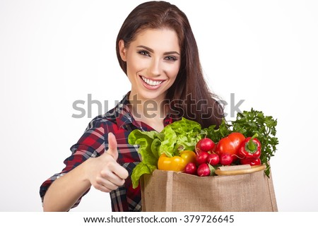 Young woman with a grocery shopping bag. Isolated on white background.