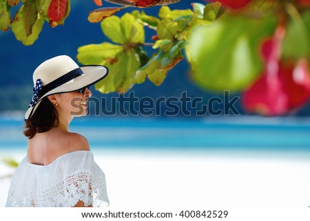Young woman with a hat enjoying summer at the beach, Koh Phangan island, Thailand, Asia - stock photo