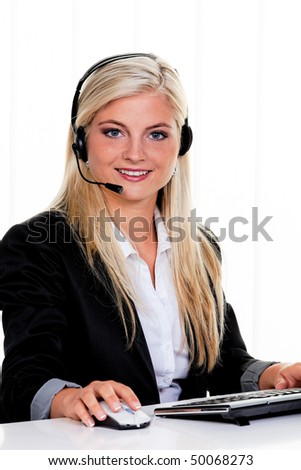 Young woman with a headset and computer hotline.