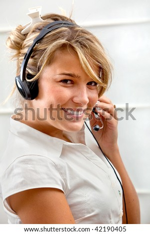 Young woman with a headset and smiling - stock photo