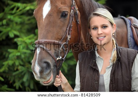 young woman with a horse - stock photo