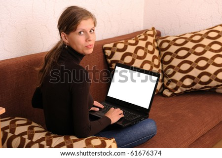young woman with a laptop - stock photo