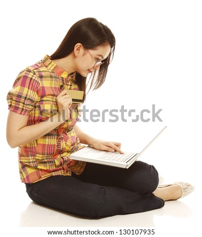 Young woman with a laptop and a credit card