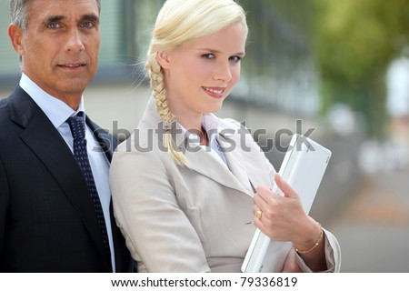 Young woman with a laptop and an older man - stock photo