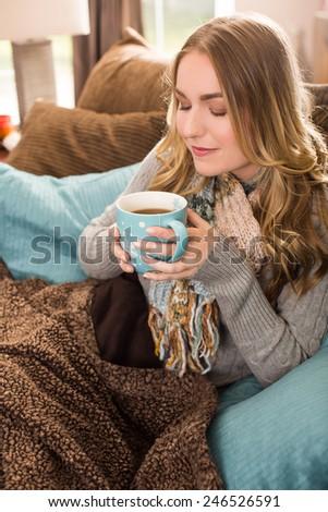 Young woman with a large mug of tea - stock photo