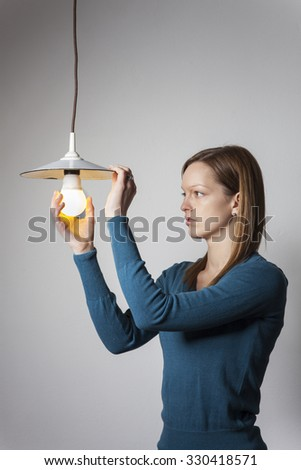 young woman with a light bulb  - stock photo