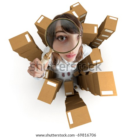 Young woman with a magnifying glass and piles of cardboard boxes - stock photo