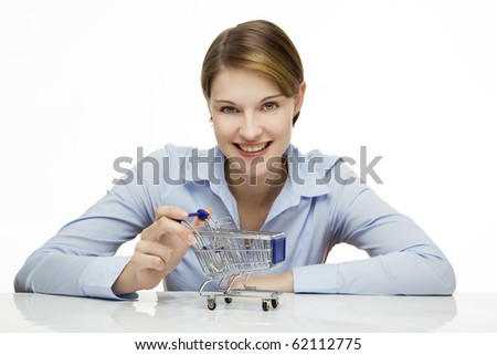 young woman with a miniature shopping cart - stock photo
