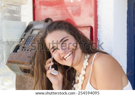 Young woman with a mobile phone outdoors