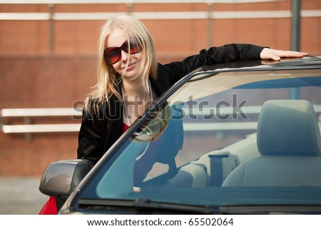 Young woman with a new convertible. - stock photo
