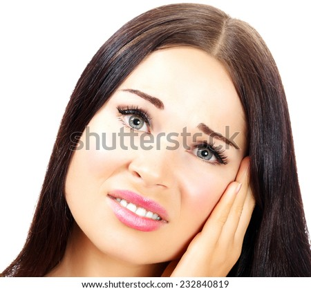 Young woman with a pain in her ear, white background, copyspace - stock photo