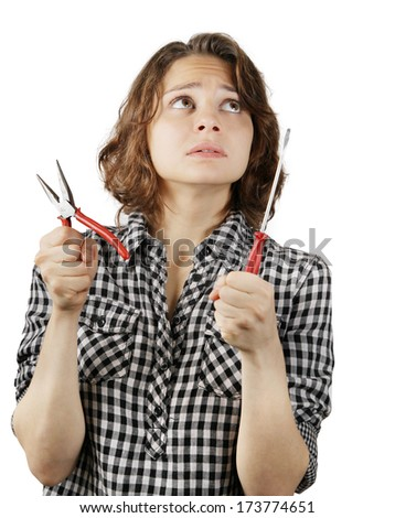 young woman with a pair of pliers and a screwdriver in his hands isolated on white background - stock photo