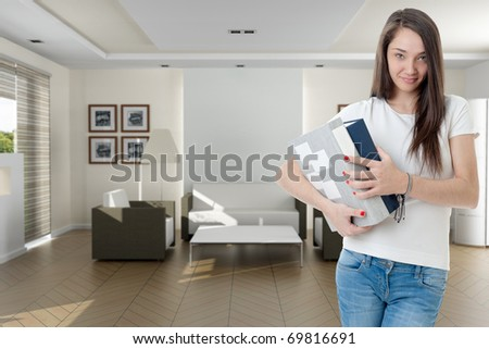 Young woman with a pair of ring binders in a home interior - stock photo