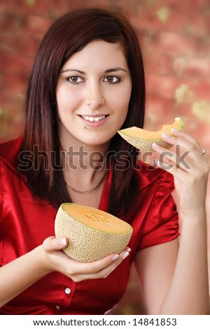 young woman with a piece of cantaloup