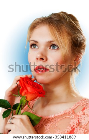 young woman with a rose in his hand. sensual emotions. white and blue background