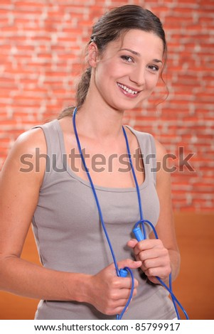 Young woman with a skipping rope - stock photo