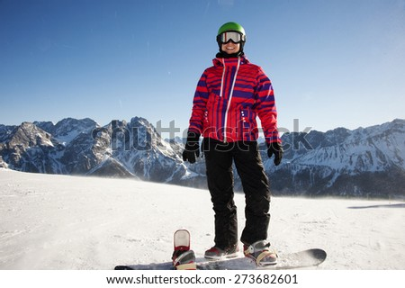 Young woman with a snowboard  - stock photo