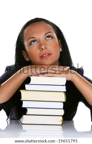 Young woman with a stack books during learn