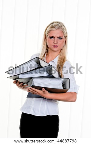 Young Woman with a stack of files folder: