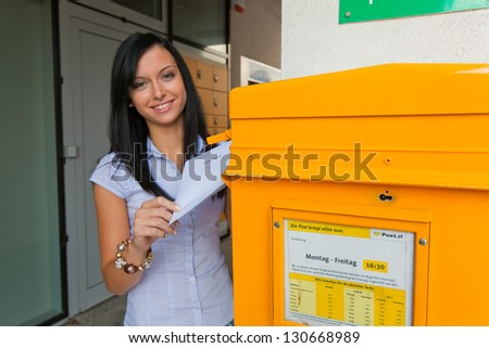 young woman with a voting card (austria) - stock photo