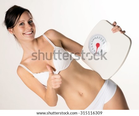 young woman with a weight scale / Diet - stock photo