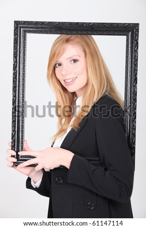 Young woman with a wooden frame