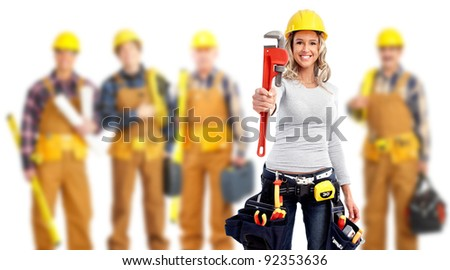 Young woman with a wrench and a group of industrial workers. - stock photo
