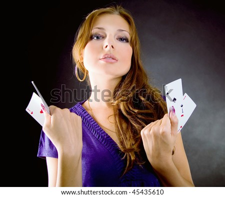 Young woman with aces four of a kind playing poker - stock photo