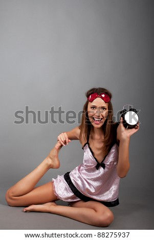 young woman with alarm clock - stock photo