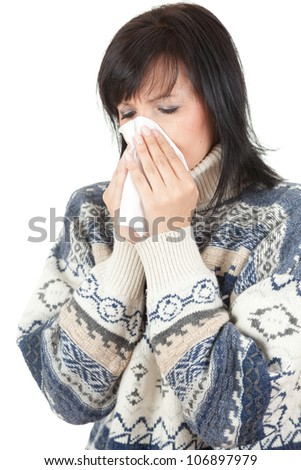 young woman with allergy or cold holding handkerchief, white background - stock photo