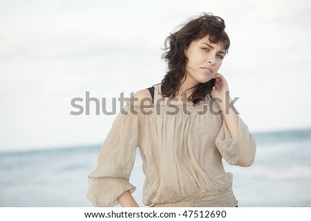 Young woman with an ocean horizon in the background