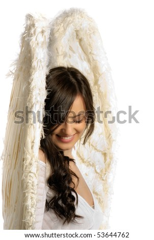 Young woman with angel wings smiling isolated on white