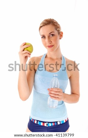 Young woman with apple and water isolated - stock photo