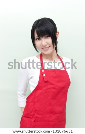 young woman with apron - stock photo