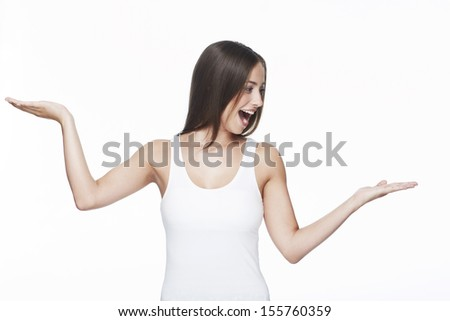 Young woman with arms out against white background - stock photo