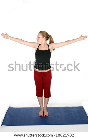 young woman with arms out on blue yoga mat - stock photo