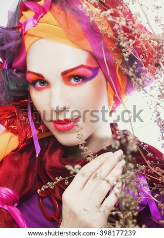 Young woman with artistic visage - stock photo