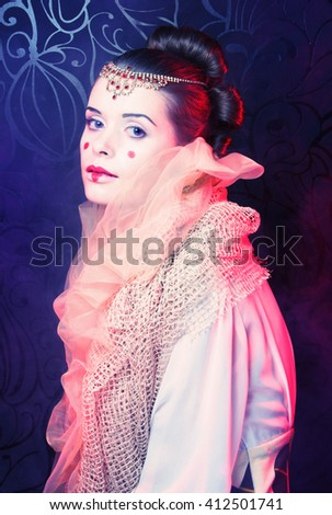 Young woman with artistic visage and hairstyle. - stock photo