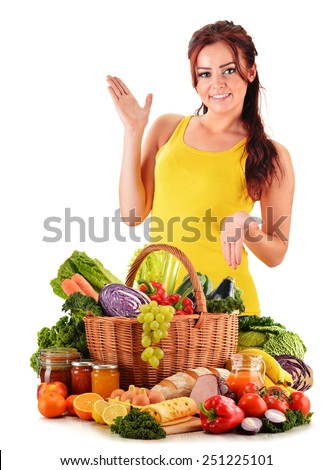 Young woman with assorted grocery products isolated on white background