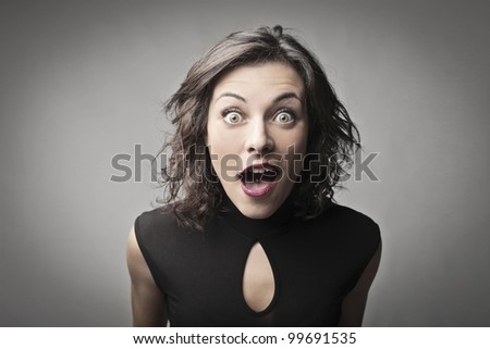 Young woman with astonished expression - stock photo
