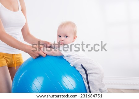 Young woman with baby - stock photo