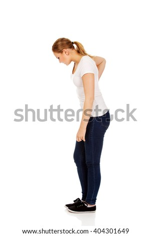 Young woman with back ache - stock photo