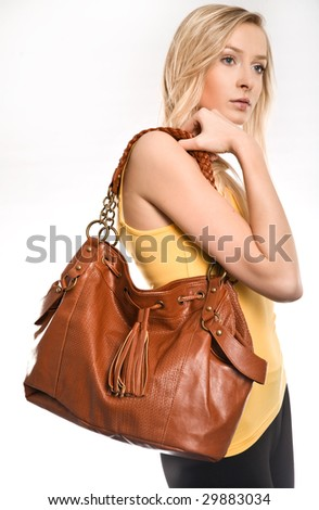 Young woman with bag isolated on white